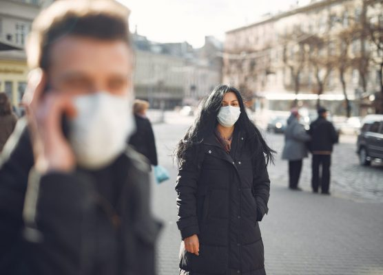 woman-in-black-coat-and-face-standing-on-street-3983428-scaled